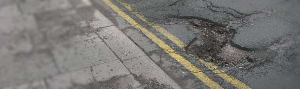 pothole in road double yellow line claim
