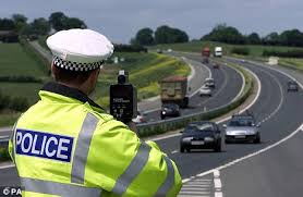 uk-driving-records-online-police-man-with-speed-camera