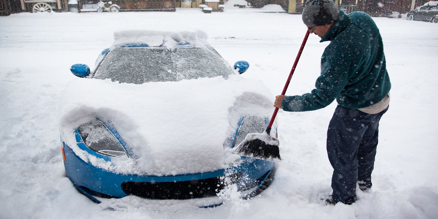 winter fuel saving tips car covered in snow