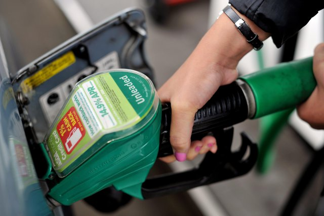 filling with supermarket fuel prices petrol green pump